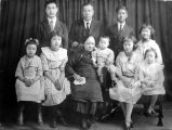 Rose Wong in family portrait-- Rose Wong is frist from right, standing. Back Row: Lee Ying Middle...
