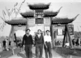 Mr. Louie, Jim Wong and Raymond Chow, in New Chinatown at the North Broadway gate