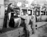 Group of seven men, George Louie, far left, brother, Ford Plant, Detroit.