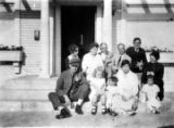 Group in front of house on Clinton Street: Lung Yep, Soy Wan Tong Lung, boy is Joe, girl is...