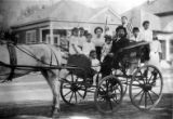 Close up of carriage with Tom Shee Bin, wife, and family. From right to left: Harriet, --, Ora,...