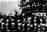 Close up of Chow Hoy in group shot of crew in the U.S. Navy.
