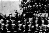 Closeup of Chow Hoy in group shot of crew in the U.S. Navy.