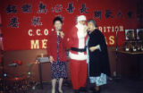 Los Angeles CCOA Nutrition Christmas party. Nancy Taneka, Santa Claus and Lily Chan singing carols