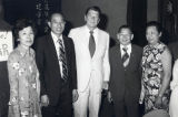 Poy Wong being appointed Overseas Affairs Commissioner. In the photo are Poy Wong and Ronald...