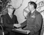 Dr. Stanley H. Chan presenting awards to Major General Dewey Lowe of the U.S. Air Force at the New...