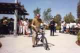 Poy Wong riding a bike at the Wong Family Association picnic