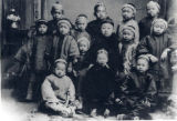 Kindergarten class of Chinese children with their teacher in the center, in Los Angeles