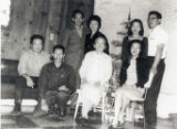 Ko Po Kwok sitting with her children at Christmas, Esther is to her right.