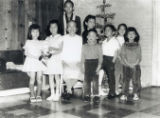 Family picture of children and grandmother, Ko Po Kwok, at Christmas.