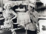 Movie scene with a blonde Caucasian woman and stereotypical Chinese man. Written on the photo is...