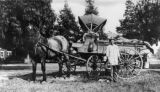 Jung Ah Mook delivers produce with his horse drawn wagon in Los Angeles in 1914.