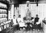 Three men sitting inside a Los Angeles Chinese herb shop