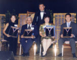 President of the Friends of the Chinese American Museum, Judge Ronald Lew, and four people who...