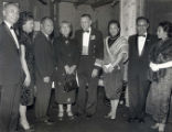 Photo of (from left to right) Dolores Wong, Wilbur Woo, Mrs. David Woo, U.S. official, Barbara...