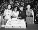 The tenth anniversary of New Life. Lily Chan and her co-workers stand in front of the cake