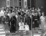 Lily Chan, founder of Women's New Life Club, and members in front of the CCBA headquarters in Los...