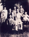 Family portrait of Ngan Gong (father), Kok Gong (mother), and Jean are seated in the center. In...