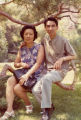 Show Fung and Chai Yip Quan (Steve Mar's maternal grandparents) seated on a tree