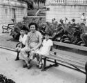 Chai Yip, Henry and Susan Quan seated on a bench in Hong Kong