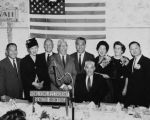 Posed photo of a small group of people, including Gee Kee Ward, Senator Hiram Fong, a Caucasian...
