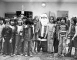 Santa Philip posed with a group of children at Castelar School