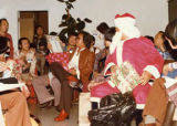 """Kellogg Chan's Christmas,"" Gerald Jann dressed as Santa Clause distributing gifts to..."