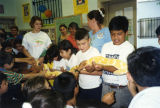 Holding a snake, Cypress Park Branch Library