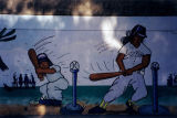 Two baseball players, a mural