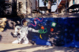 Young boy floating in space, a mural