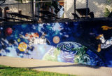 Floating in a space suit, a mural