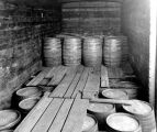Liquor barrels stacked in a railroad car