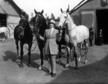 Mrs. A.C. Thompson and her horses