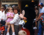 Young girl meets Mickey Mouse