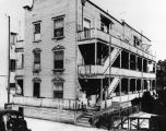 Exterior, three story slum dwelling