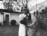 Little girl with her great dane, view 2