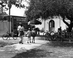 Family walks toward an LAPLTraveling Branch Bookmobile