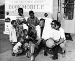 Bert Thomas and young patrons next to LAPL Bookmobile