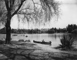 Canoers enjoy the lake at MacArthur Park