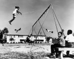 Children play in housing project playground