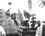 Volunteers unload food, Watts Riots