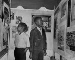 Young boys look at exhibits, Watts