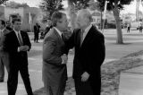 George W. Bush and Mayor Riordan shake hands
