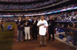 Antonio Villaraigosa listens to the Star Spangled Banner