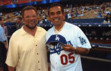 Antonio Villaraigosa and game announcer, Dodger Stadium