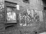 Newspapers on wall at Ferguson Alley