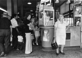 Shoppers near the popcorn stand at Grand Central