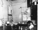 Child in kitchen, slum dwelling