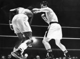 Ray Coleman (left) ducks under whistling left hook thrown by Raul Rojas in third round