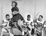 Cheerleader Judy Anderson displays ball handling class